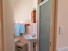 Full bathroom with shower & basin