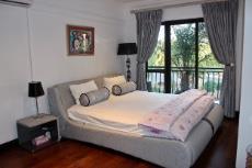 2nd Bedroom with wood veneer cupboards and engineered wood flooring