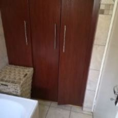 Linen cupboard in bathroom