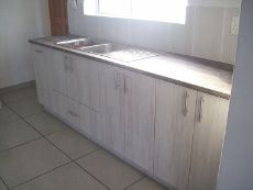 Kitchen with double sink and cupboards