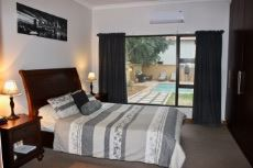 Main bedroom with view of the pool