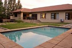 Backyard with pool and boma