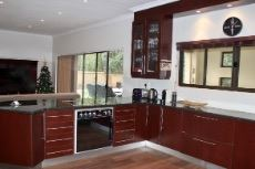 Open-plan kitchen and lounge with sliding doors to patio areas