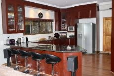 Open-plan kitchen with serving hatch to braai area