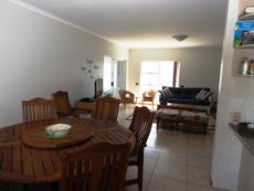 Dining & Living Area, BBQ Room on far left & Kitchen on our right.