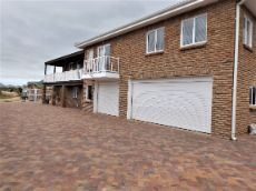 Paved driveway and four Garages.