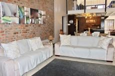 Lounge with exposed brick feature wall