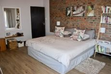 Main bedroom with exposed brick feature wall