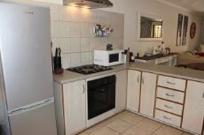 Open-plan kitchen with electric oven and hob