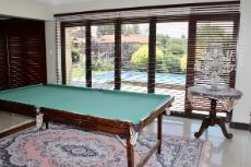 Entertainment area with folding doors to pool