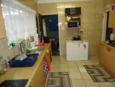 Kitchen With Melamine Cupboards, Formica Tops, Stove
