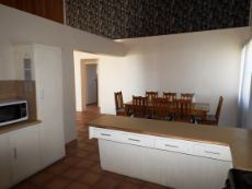 1st Floor: Part of Kitchen (from opposite side); Dining Area at back.