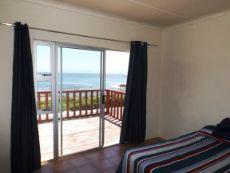 1st Floor:  Main Bedroom on side of ocean - accessing front Balcony.