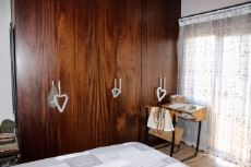 Main bedroom mahogany veneer cupboards