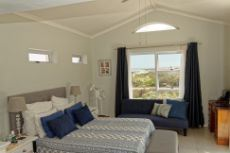 Main bedroom with ocean views & private balcony
