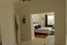 Main bedroom with dressing room from bathroom entrance