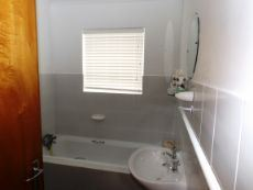 Bathroom (with bath, shower & wash basin).