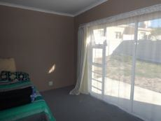 Same en suite Main Bedroom; accessing Backyard via sliding door.