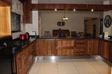 Kitchen interior.  Wooden cupboards and granite countertops.