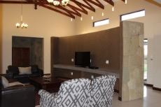 Open-plan lounge with built-in TV unit.