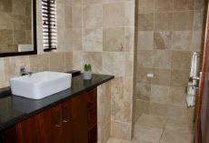En-suite bathroom with shower.