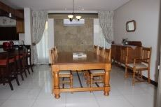 Open-plan dining area with air-conditioner.