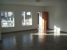 living room with front door from stoep