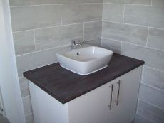 on-suite basin and cupboard