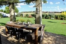 Open patio with pergola adjacent to braai room and TV room