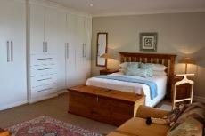 Main bedroom with built-in cupboards