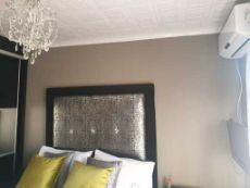 Modern light fittings and aircon in main bedroom