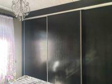 Lots of sliding cupboard doors in main bedroom