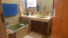 bathroom with bath, basin and toilet.