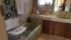 En suite full bathroom with bath, basin and shower.