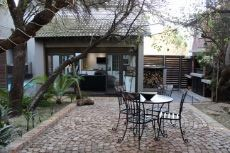 Outdoor seating and braai area