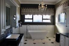 Main en-suite bathroom with his & hers basin vanity