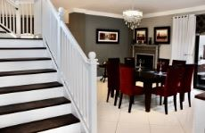 Staircase to 1st floor living area and family bedrooms