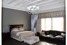 Main bedroom with exposed roof trusses