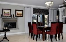 Dining area with fireplace and folding doors to deck