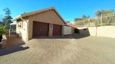 Double garage with outomated doors and carport.