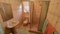 Second bathroom with shower, basin and toilet