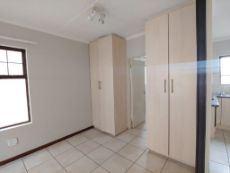 Bedroom cupboards,  with door to bathroom