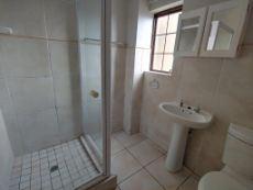 Bathroom with shower, basin, toilet