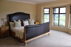 North-facing main bedroom with bay windows
