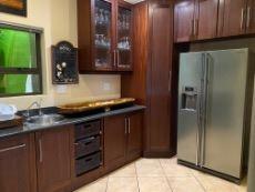 Kitchen with mahogany veneer cupboards