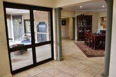 Folding doors between lounge and patio