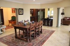 Dining area with view into kitchen and lounge