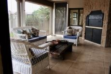 Patio with built-in braai and roller blinds