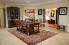 Dining area with view into entrance hall