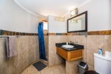 Conference area bathroom with shower and toilets